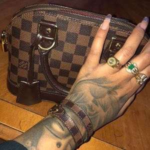 Brown Louis Vuitton with matching bracelet